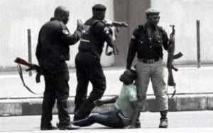 protest_pictures_Ademola_Aderinde_being_molested_150851430